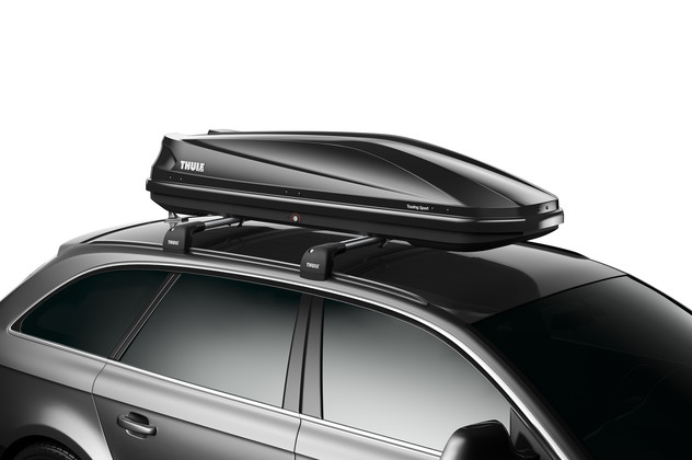 Black roof box Thule Touring 600 on car