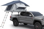 Thule Xsporter Pro Mid 500011 on truck with roof top tent