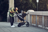Man with baby stroller Thule Spring