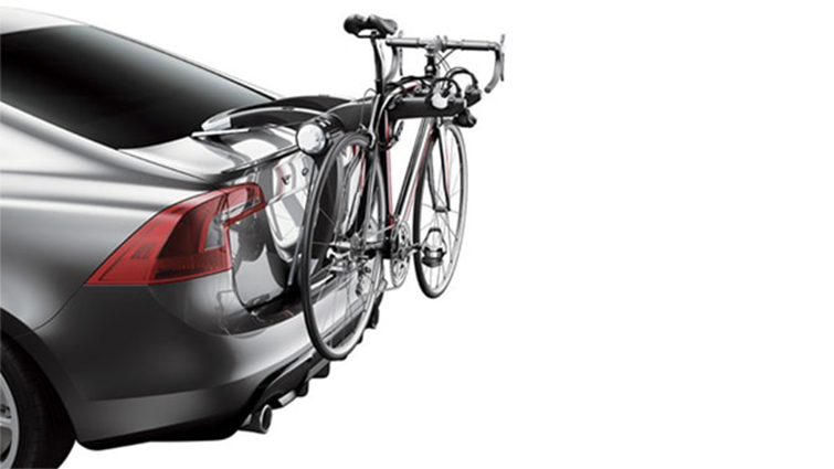 A bike rack mounted on the rear of the car